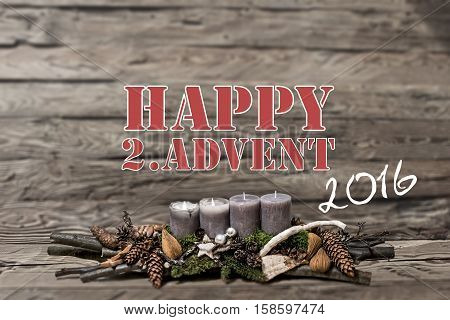 Merry Christmas decoration advent 2016 with burning grey candle Blurred background text message englisch 2nd