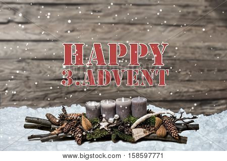 Merry Christmas decoration advent 2016 with burning grey candle Blurred background snow text message englisch 3rd