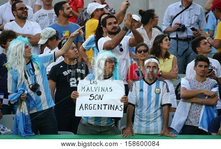 RIO DE JANEIRO, BRAZIL - AUGUST 14, 2016: Argentinian fans support Grand Slam champion Juan Martin Del Potro of Argentina during men's singles tennis final of the Rio 2016 Olympic Games