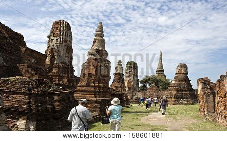 AYUTTHAYA, THAILAND - November 4, 2016: People visiting the Wat Mahathat temple complex in Ayutthaya central Thailand