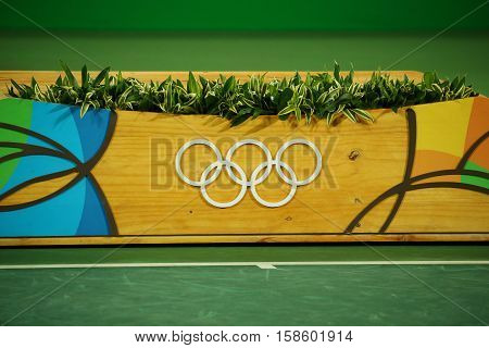 RIO DE JANEIRO, BRAZIL - AUGUST 14, 2016: Medal podium during tennis men singles final medal ceremony at the Maria Esther Bueno Court of the Rio 2016 Olympic Games at the Olympic Tennis Centre