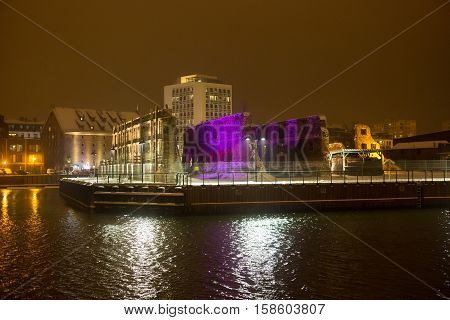 Granary island with old ruins in the night illumination color in Gdansk. Poland.
