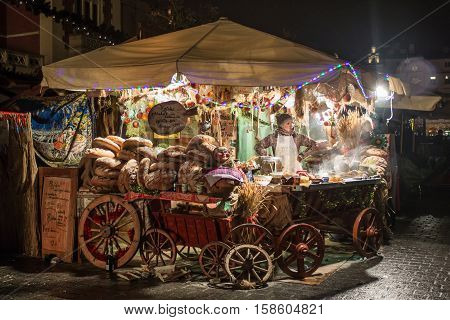POLAND KRAKOW - JANUARY 01 2015: Festive New Year Fair in night Krakow on the Main Market Square in the historic center of the old town.