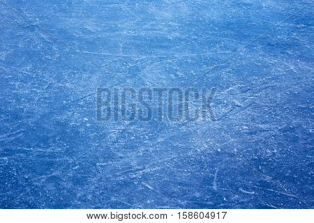 Texture of a blue ice with scratches on surface.