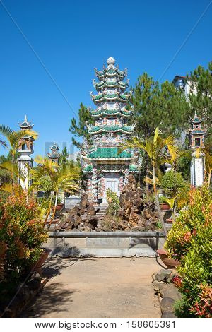 The old Pagoda in the courtyard of a buddhist monastery Lin Son. Da Lat, Vietnam