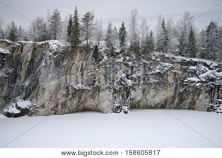 Gloomy January day on the Marble lake. Mountain Ruskeala park. Karelia