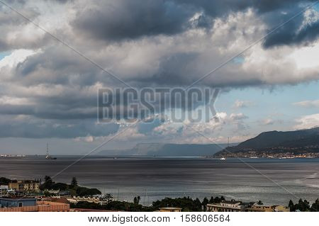 The Messina Strait seen from Sicily Italy. Beautiful moving clouds over vast spaces.