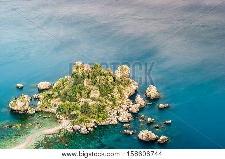 Beautiful landscape of Taormina, Italy. Sicilian seascape with beach and island Isola Bella. Travel photography.