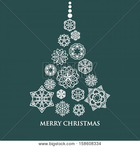 White snowflake set Christmas tree on green background