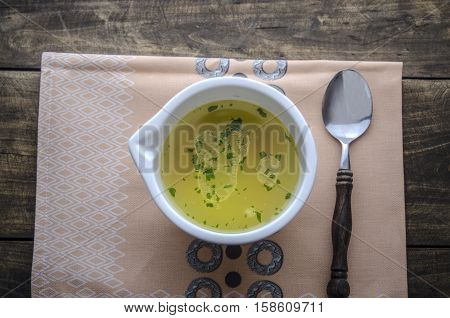 chicken noodle soup on wooden table from above