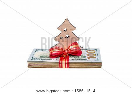 Christmas background with Christmas tree and a wad of US currency,isolated on white background