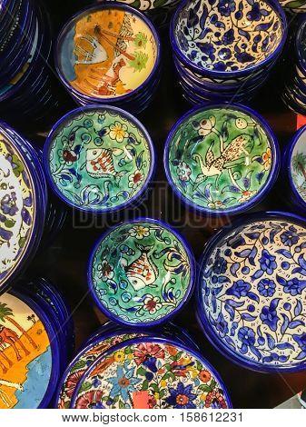 Moroccan handmade crockery. Plenty of decorative handmade bowls and plates displayed in a souvenir shop.