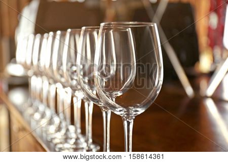 Row of empty wine glasses on bar counter