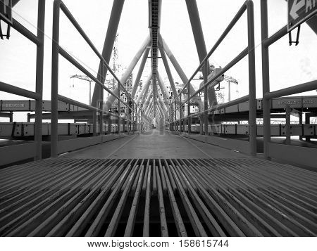 Bridge platform connected between wellhead platform and central processing platform that is route of support of oil and gas piping from remote to central processing platform underneath bridge