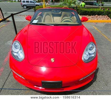 Las Vegas, United States of America - May 05, 2016: Luxurious and Colorful Cars for Rent Waiting in the Parking Lot of a Supermarket on the Las Vagas Strip, Nevada on May 05, 2016