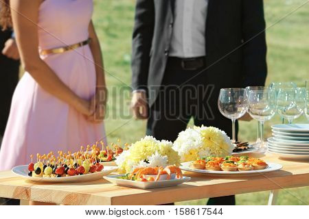 Table served outdoors for buffet catering party