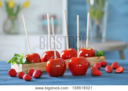 Candy apples on blurred background