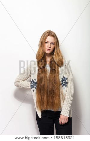 Human pose expressions and emotions. Portrait of young adorable redhead woman showing her gorgeous extra long natural red hair in cozy sweetshirt