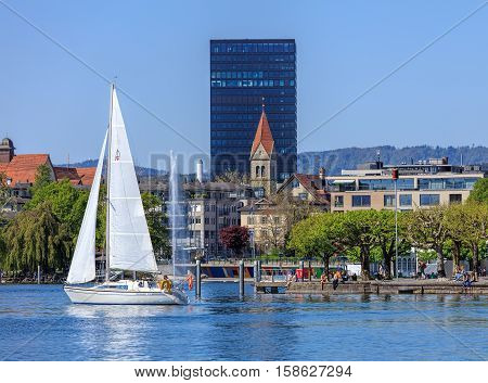 Zug, Switzerland - 6 May, 2016: view on the city of Zug from Lake Zug. The city of Zug is the capital of the Swiss canton of Zug. Lake Zug is a lake in central Switzerland, situated between Lake Lucerne and Lake Zurich.