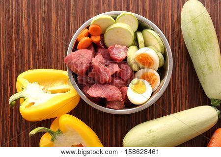 Healthy dog food on wooden background