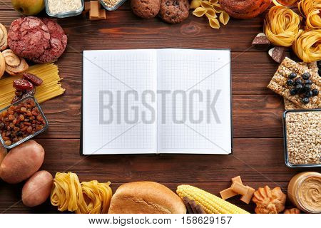 Open notebook and ingredients for cooking