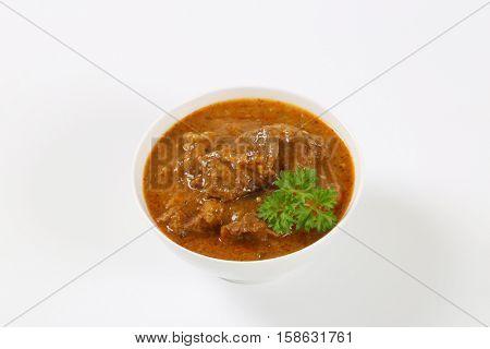 bowl of fresh beef goulash on white background