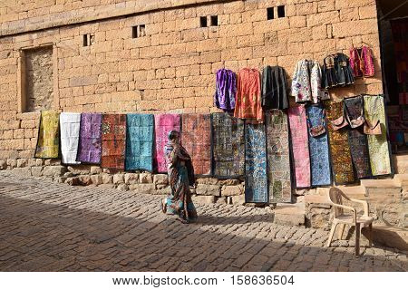 JAISALMER, RAJASTHAN, INDIA - FEBRUARY 11, 2016 - Carpets and traditional dresses on the walls of Jaisalmer fort