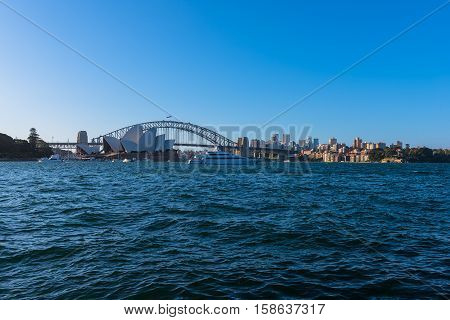 View of  Sydney Opera House And Harbour Bridge Sydney Australia from Mrs macqurie's Chair.NOV 28,2016. Sydney Opera House is modern building, well known worldwide. Designed by Danish architect John Byers industry Saunders.