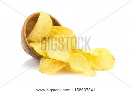 Potato chips and a small wooden bowl on white background