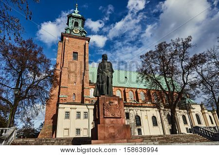Statue and cathedral church in Gniezno Poland