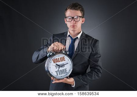 Young businessman time importance concept