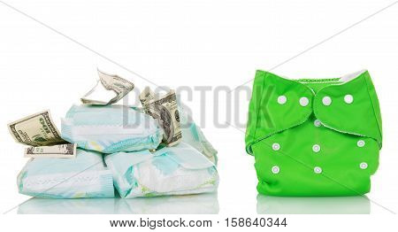 Reusable and disposable diapers, dollars isolated on white background