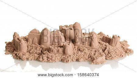 Battered beautiful sandcastles isolated on white background