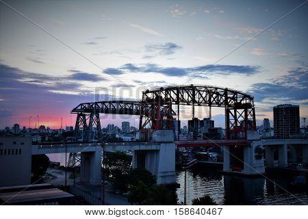 IRON BRIDGES OF LA BOCA WITH SUNSET