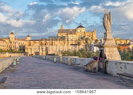 Sculprure depicting St. Raphael in the middle of Roman bridge of Cordoba Andalusia Spain