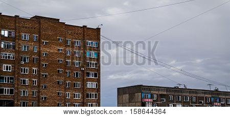Two cheap apartment buildings, housing complex, social housing. Apartment buildings