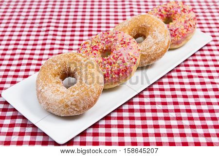 A tray of four different assorted donuts