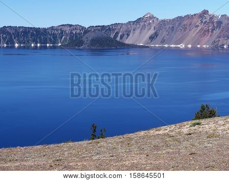 Wizard Island seen across Crater Lake on a sunny summer morning.