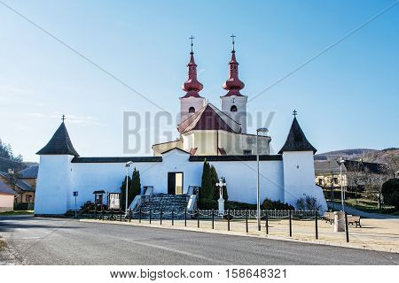 Roman catholic church in Divin village Slovak republic. Religious architecture. Cultural heritage. Beautiful place. Jesus Christ on the cross.