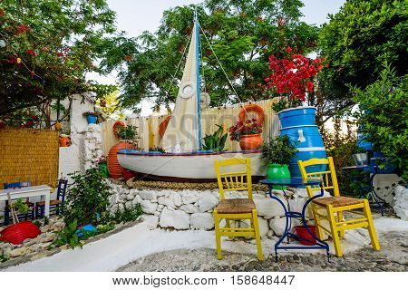 Kos island, Dodecanese, Greece - May 17, 2016: the interior is traditional Greek fish restaurant with colorful chairs and flowers.