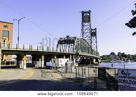 Portsmouth New Hampshire USA - August 9 2009: Previous World War I Memorial Bridge between Portsmouth New Hampshire and Kittery Maine before the center span was demolished in 2012 and a new bridge built in its place