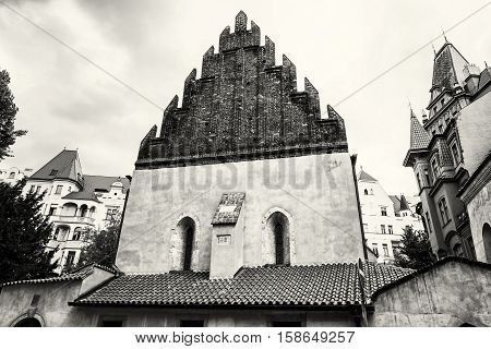 Old new synagogue near High synagogue in Prague Czech republic. Architectural theme. Religious architecture. Black and white photo. Travel destination.