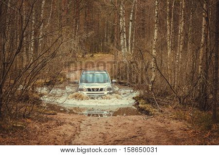 Leningrad Oblast, the Karelian isthmus, Russia,March 15, 2014. Nissan X trail water barrier, the Nissan X trail is a compact four wheel drive off road and sport utility vehicle