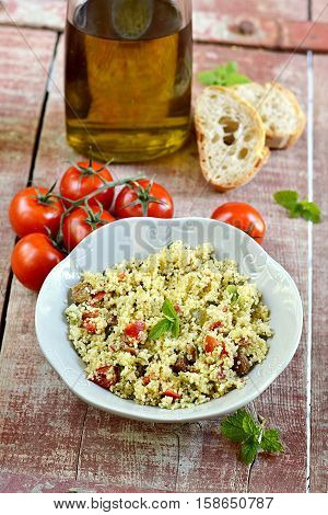 Arabian couscous salad with fresh vegetables Tabouleh