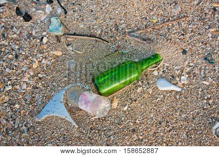 bottles and garbage on a beach environmental pollution