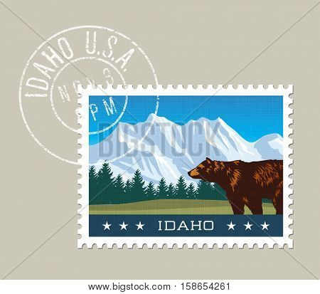 Idaho postage stamp design. Vector illustration of snowy mountains and grizzly bear. grunge postmark on separate layer