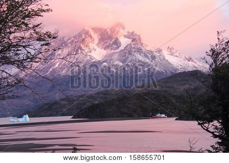 Sunrise Over Lago Grey, Torres del Paine National Park in Chile captures pink colors.