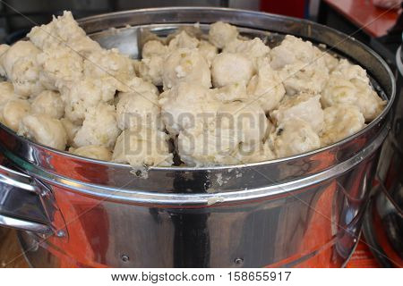 Traditional Indonesian dumplings snacks fast food peanut sauce