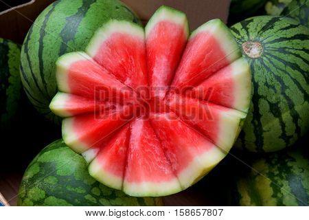 Ripe watermelon in market in Birmingham city center. Sliced fresh watermelon in the market