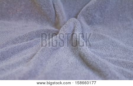 Closeup view of towel. Fluffy gray background